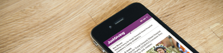 An iphone which shows the Justgiving website mobile view on the screen